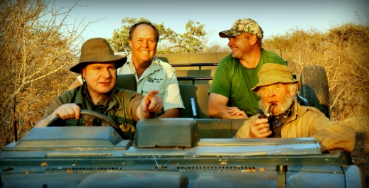 Director driving with Guy Wallace and safari hunters
